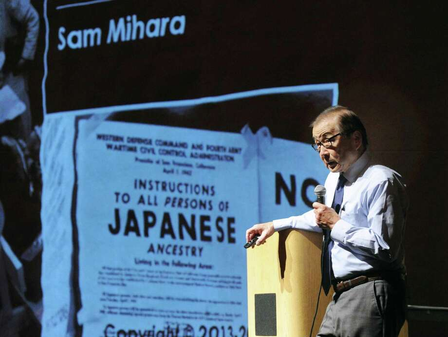 Sam Mihara of Huntington Beach, California, tells the story of the mass imprisionment of Americans of Japanese heritage during World War II that he experienced as a child, while giving a speech to students at the Greenwich High School Performing Arts Center, Conn., Thursday, Dec. 7, 2017. Photo: Bob Luckey Jr. / Hearst Connecticut Media / Greenwich Time