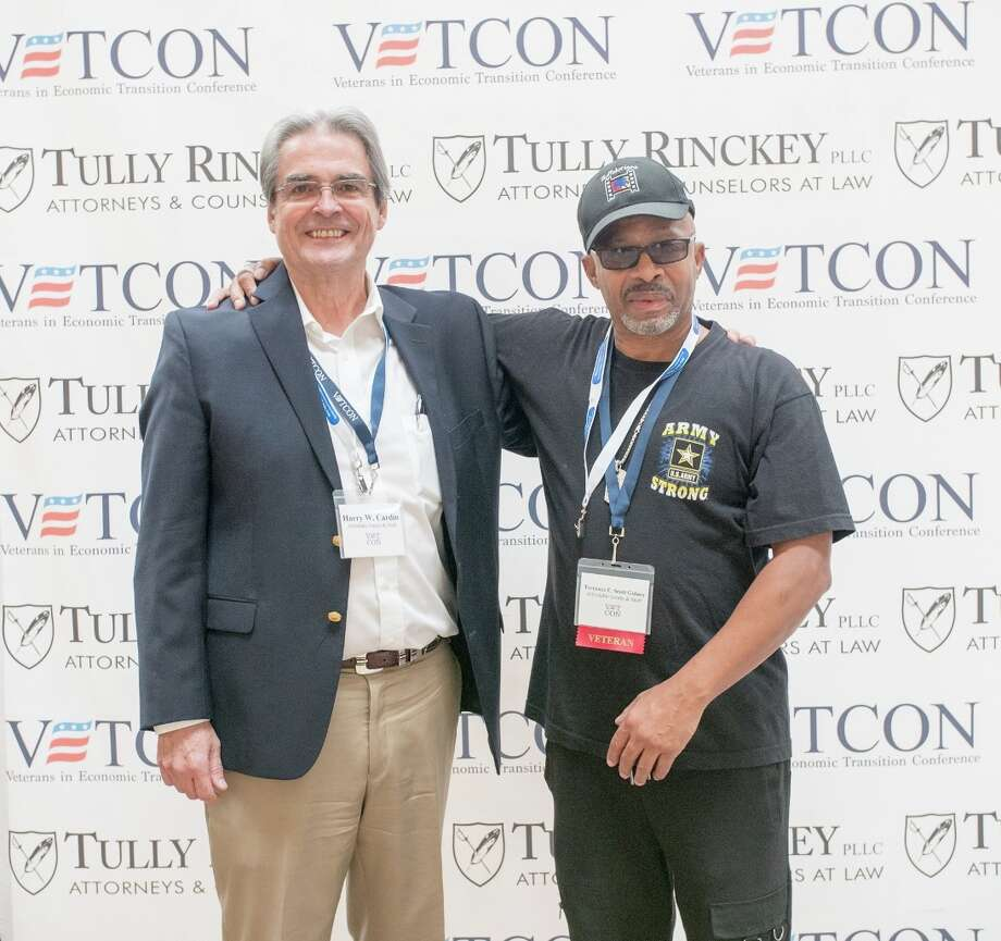 Terrence Gidney and Harry Cardin of Affordable Scrubs & Stuff of Buffalo are the winners of a business plan competition at the Veterans in Economic Transition Conference (VETCON) at the Desmond conference center in Colonie. More than 400 people, mainly military veterans, attended the two-day conference Nov. 28 and 29. The competition allowed aspiring veteran business owners the chance to pitch their plans to a panel of judges. Second place went to Mr. Electric, based in Queensbury.