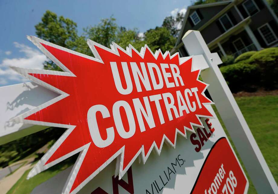 FILE - In this Tuesday, May 16, 2017, file photo, a sign advertises that an existing home for sale is under contract in Roswell, Ga. Surging stock prices and steady increases in home values powered American household wealth to $96.9 trillion in the fall of 2017, though the gains aren't widely shared. (AP Photo/John Bazemore, File) ORG XMIT: NYBZ415 Photo: John Bazemore / Copyright 2017 The Associated Press. All rights reserved.