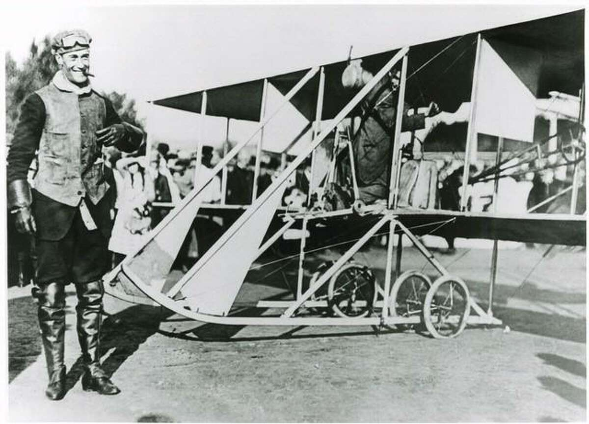 Pilot Cal Rodgers is ready for takeoff with a crowd in the background.