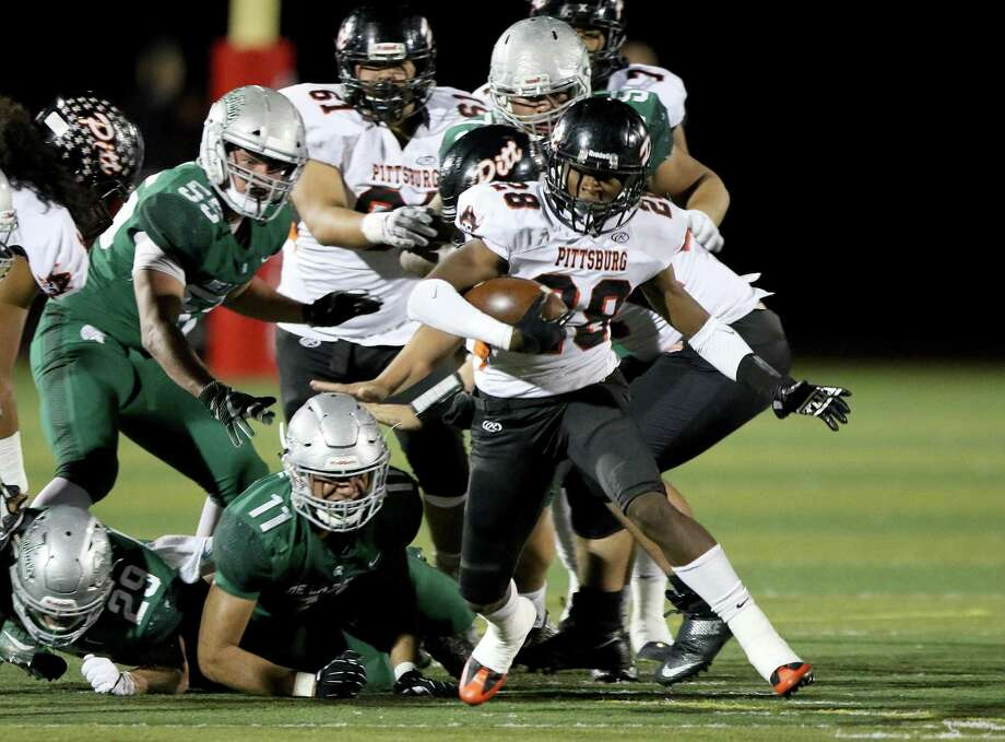 Pittsburg's Premier Murphy (28) breaks out of a pack on December 2, 2017 after a playoff football game against De La Salle. De La Salle went on to win the contest  24 - 7 over Pittsburg Photo: Dennis Lee / Courtesy Dennis Lee / 2017, Dennis Lee