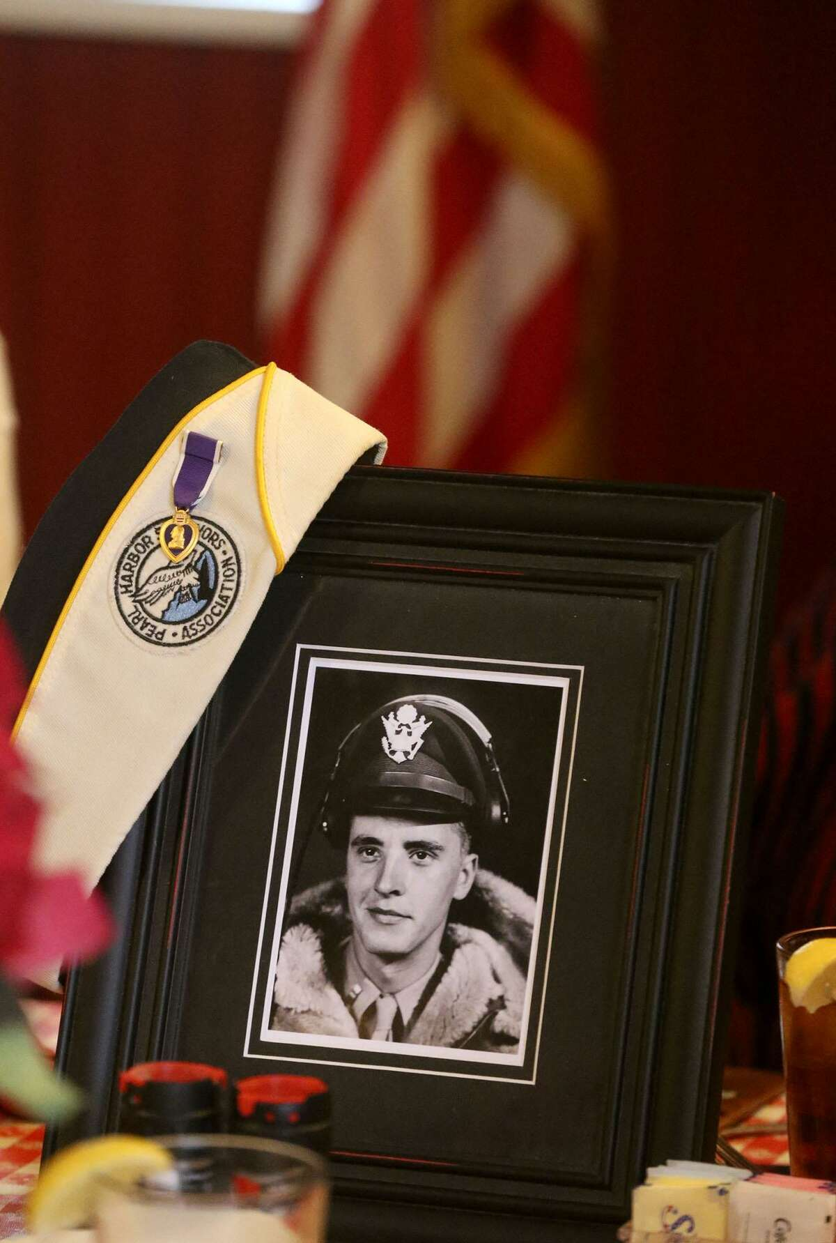 A photo of Pearl Harbor survivor Richard Anderson was placed on a table Thursday December 7, 2017 at a lunch held at the Barn Door restaurant in honor of Pearl Harbor survivors. Anderson later in the war became a B-24 bomber pilot. Richard Anderson passed away last October. Pearl Harbor was attacked by the Japanese December 7, 1941.