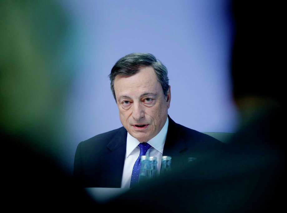 FILE - In this Thursday, April 27, 2017 file photo, the President of the European Central Bank Mario Draghi speaks during a news conference in Frankfurt, Germany. A key global forum of banking regulators has completed a new set of rules aimed at keeping bad banks from needing taxpayer bailouts and hurting the economy, it was reported on Thursday, Dec. 7, 2017. Under the latest rules, banks must keep at least 7X percent of the capital buffers under their own internal risk calculations, compared to a stricter measure used by regulators.(AP Photo/Michael Probst, File) Photo: Michael Probst, STF / Copyright 2017 The Associated Press. All rights reserved.