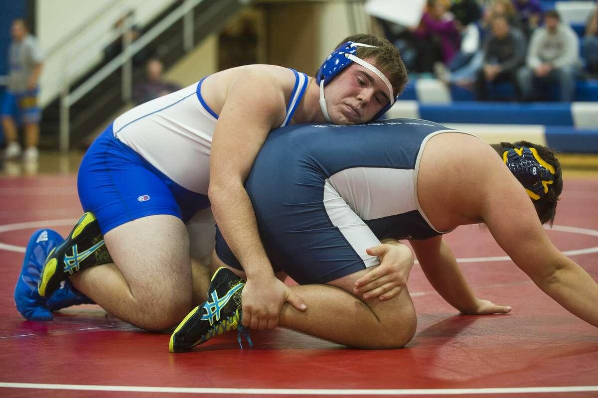 Coleman's Bryce Middleton, left, wrestles Valley Lutheran's Matt Wilkins on Thursday, Dec. 7, 2017 at Coleman High School. (Katy Kildee/kkildee@mdn.net)