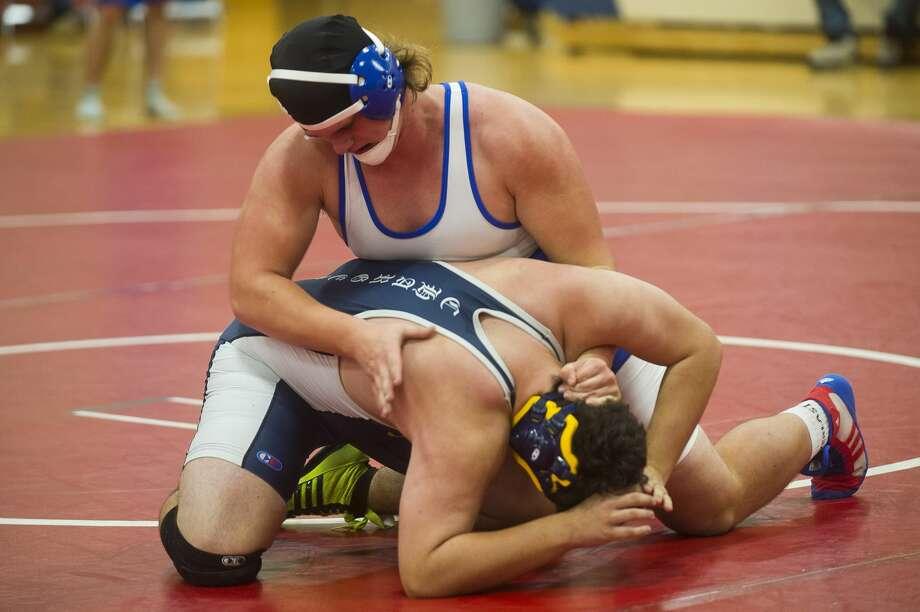 Coleman's Cooper Cozat, top, wrestles Valley Lutheran's Robert Wooten on Thursday, Dec. 7, 2017 at Coleman High School. (Katy Kildee/kkildee@mdn.net) Photo: (Katy Kildee/kkildee@mdn.net)