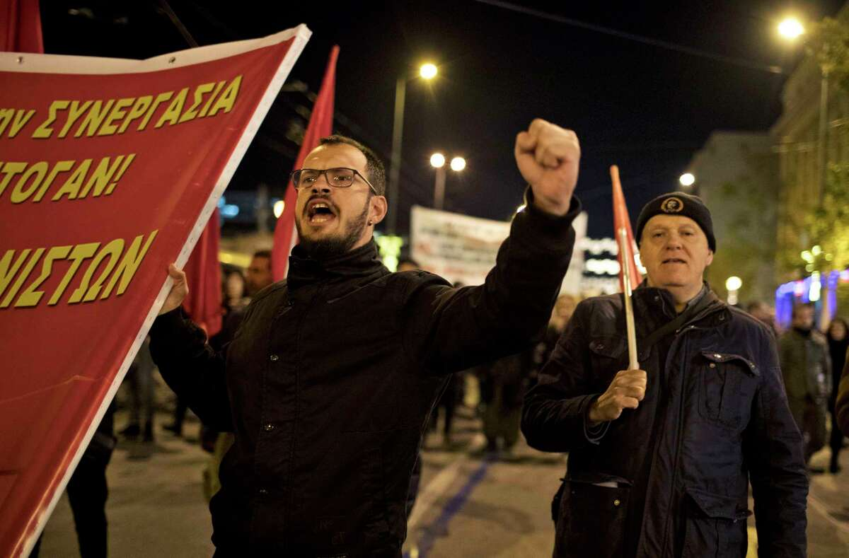 Demonstrators march against Turkey's President Recep Tayyip Erdogan's visit in Athens, Thursday, Dec. 7, 2017. Many sources of tension remain between Greece and Turkey, neighbours with historically fragile relations who have come to the brink of war three times since the 1970s. Decades-old thorny issues include territorial disputes in the Aegean, the Muslim minority in northeastern Greece and the continued occupation by Turkish troops of northern Cyprus. (AP Photo/Petros Giannakouris)