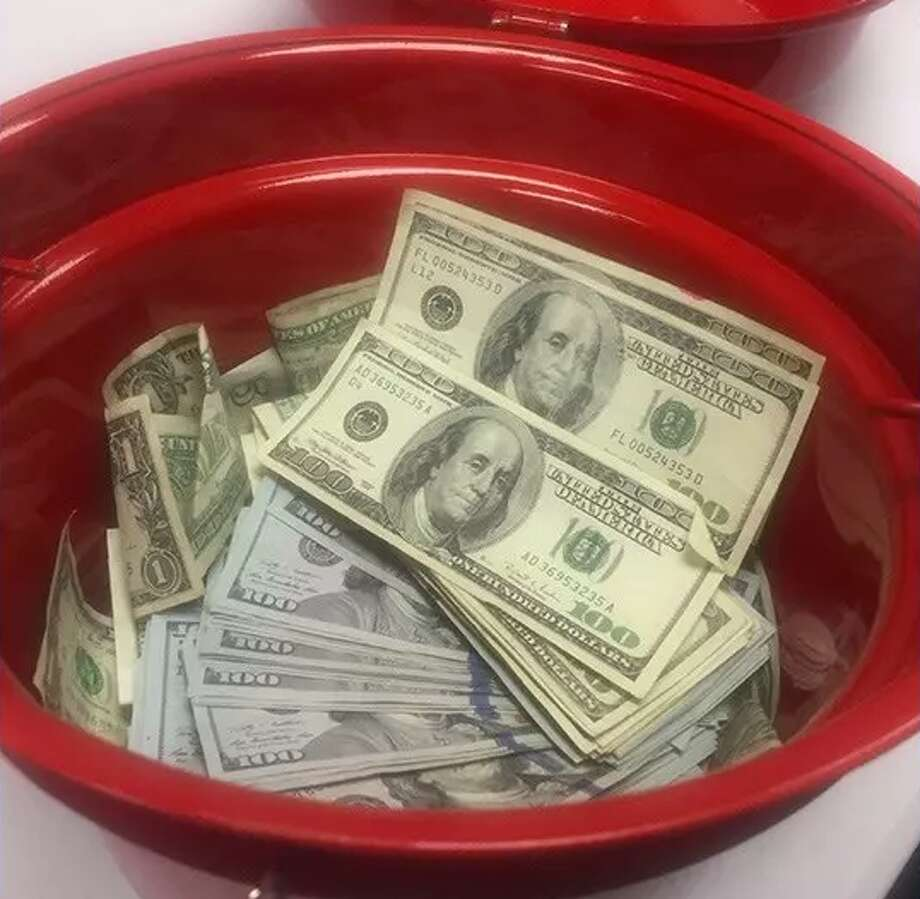 An anonymous donor dropped $10,000 in a Salvation Army donation bucket in North Portland on Tuesday. Photo: Salvation Army