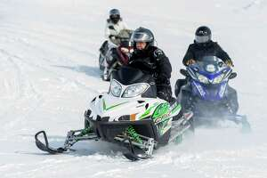 Governor Andrew M. Cuomo goes snowmobiling Thursday, Feb. 19, 2015, in Lowville, N.Y., during an announcement to promote winter tourism. (Office of the Governor)