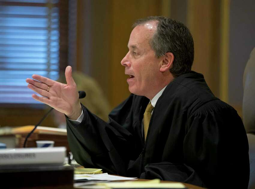 State Supreme Court Justice Gerald Connolly speaks during a hearing on new snowmobile trails being carved through the Adirondack forest on Monday, Dec. 5, 2016, in Albany, N.Y. The definition of a tree is at the heart of a lawsuit claiming the new trails violate the