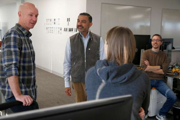 AliveCor CEO Vic Gundotra (center) meets with members of his design and engineering team including Jim Jenkins, Melissa McLean and Christian Miller at the company�s office in Mountain View, Calif. on Thursday, Dec. 7, 2017. AliveCor just received FDA approval for its Kardia Band EKG-monitoring wristband for the Apple Watch.