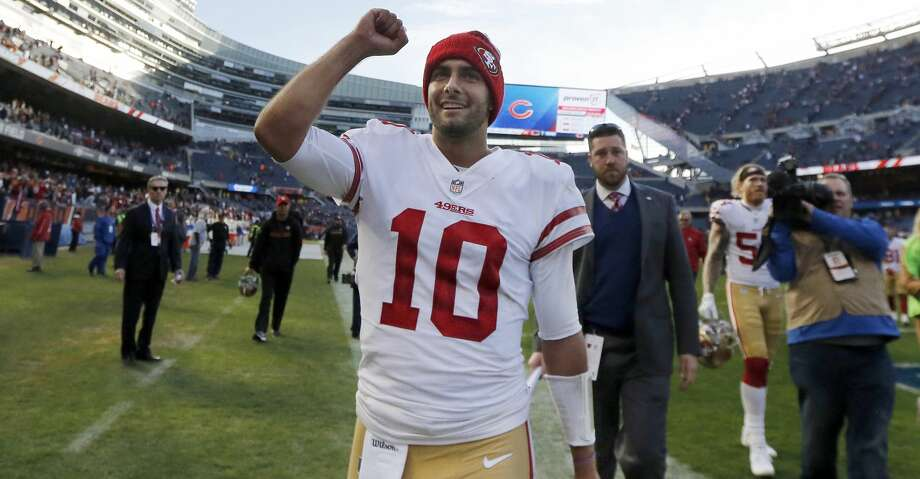 FILE - In this Sunday, Dec. 3, 2017, file photo, San Francisco 49ers quarterback Jimmy Garoppolo (10) celebrates after their 15-14 win over the Chicago Bears in an NFL football game in Chicago. Garoppolo looks to follow up a successful first start for the 49ers with another this week against Houston. (AP Photo/Charles Rex Arbogast, File) Photo: Charles Rex Arbogast/Associated Press