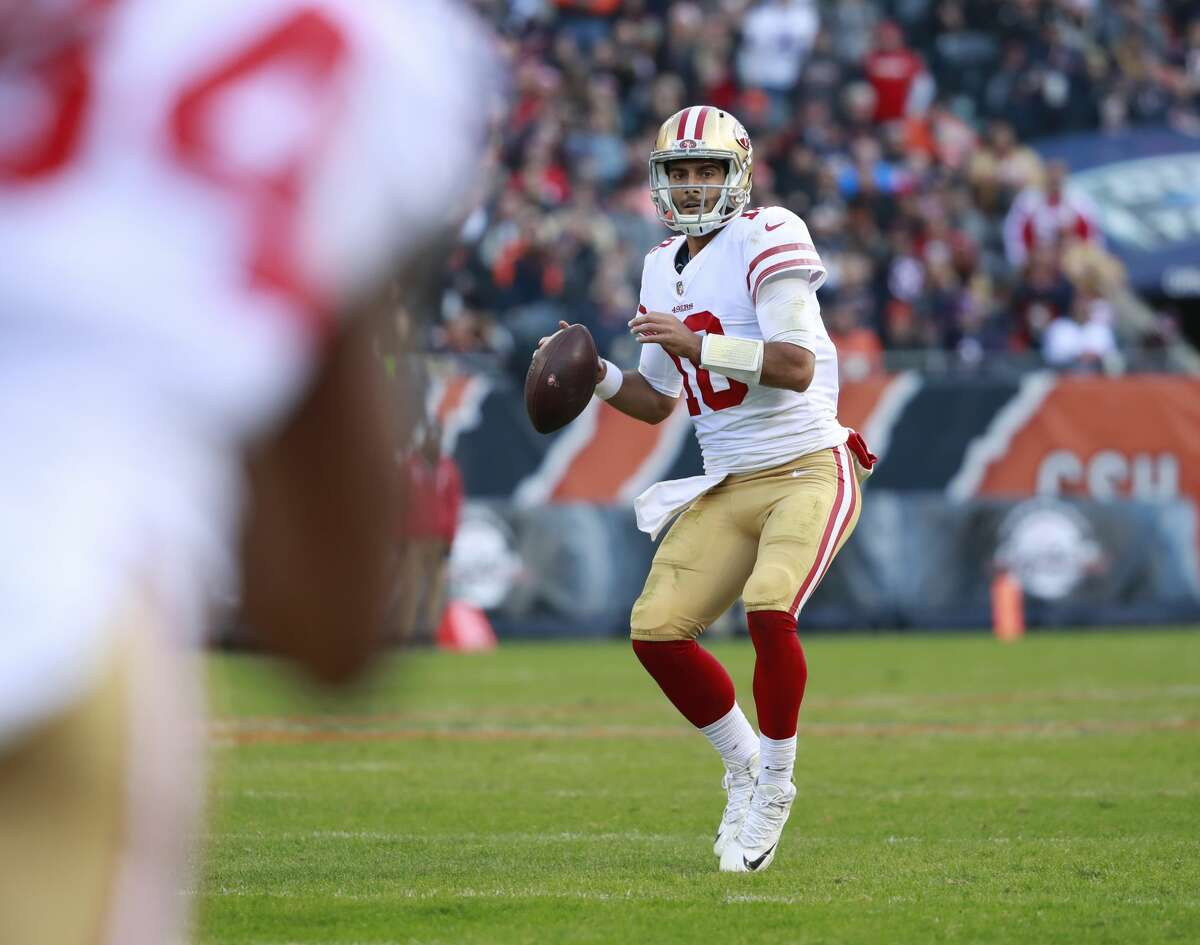 San Francisco 49ers quarterback Jimmy Garoppolo (10) looks to throw a pass against the Chicago Bears during an NFL football game Sunday, Dec. 3, 2017, in Chicago. The 49ers won the game 15-14. (Jeff Haynes/AP Images for Panini)