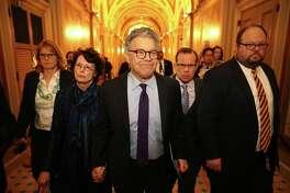 Sen. Al Franken, D-Minn., and his wife, Franni Bryson, arrive Thursday at the Capitol for his speech.