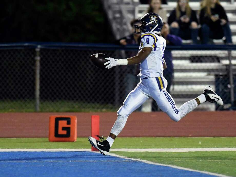 Troy's Dev Holmes (8) scores a touchdown against Schenectady during the first half of a Section II Class AA high school football game in Schenectady, N.Y., Friday, Sept. 29, 2017. (Hans Pennink / Special to the Times Union) ORG XMIT: HP114 Photo: Hans Pennink / Hans Pennink