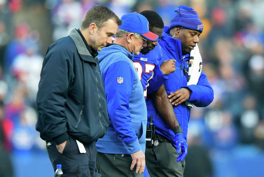FILE - In this Sunday, Dec. 3, 2017, file photo, Buffalo Bills trainers assists cornerback Tre'Davious White (27) off the field after being injured on a late hit by New England Patriots tight end Rob Gronkowski  during the second half of an NFL football game, Sunday, Dec. 3, 2017, in Orchard Park, N.Y. (AP Photo/Rich Barnes, File) ORG XMIT: NYDD214 Photo: Rich Barnes / FR171545 AP