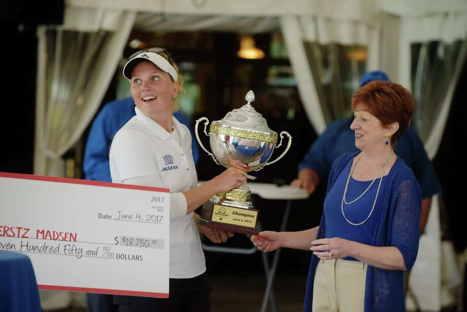 Nanna Koerstz Madsen, left, receives the trophy from Albany Mayor Kathy Sheehan after winning the Fuccillo Kia Classic of New York, a Symetra Tour event on Sunday, June 4, 2017, at Capital Hills Golf Course in Albany, N.Y.   (Paul Buckowski / Times Union) Photo: PAUL BUCKOWSKI / 40040663A