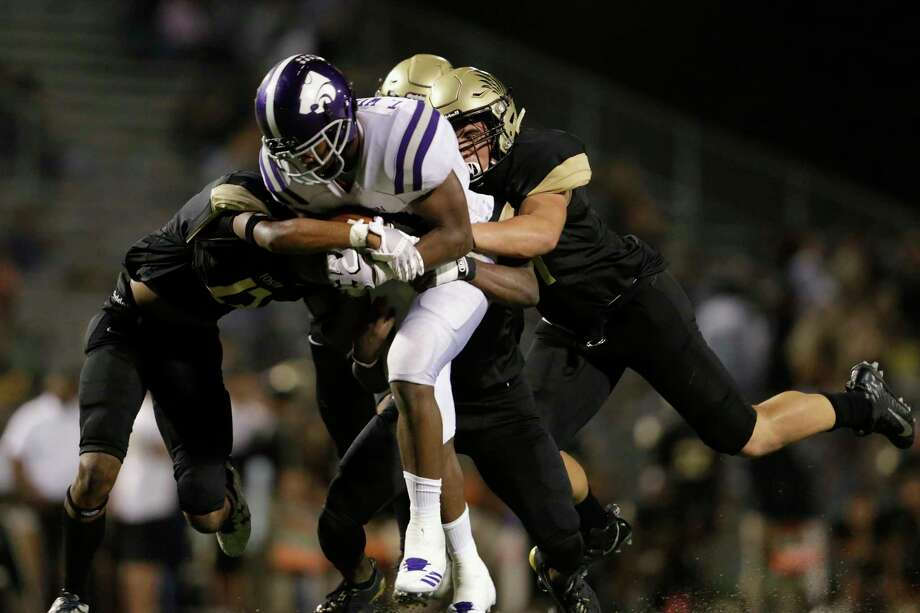 Angleton's Tamerik Williams (21) has 1,606 yards and 20 touchdowns this season. Photo: Tim Warner, Freelance / Houston Chronicle