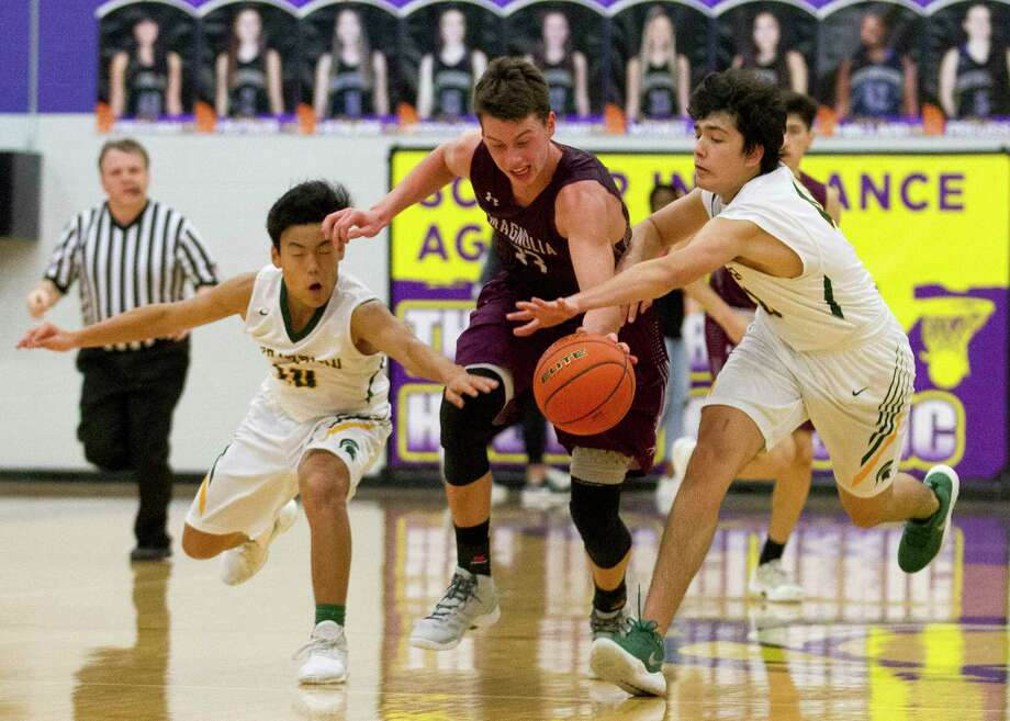 Magnolia forward Jackson Maffatt (33) fights for control of the ball against Stratford guard Jayson Roberson and power forward Mark Murdock and during the fourth quarter of a game in the Schurr Holiday Tournament at Montgomery High School, Thursday, Dec. 7, 2017, in Montgomery. Photo: Jason Fochtman, Staff Photographer / © 2017 Houston Chronicle