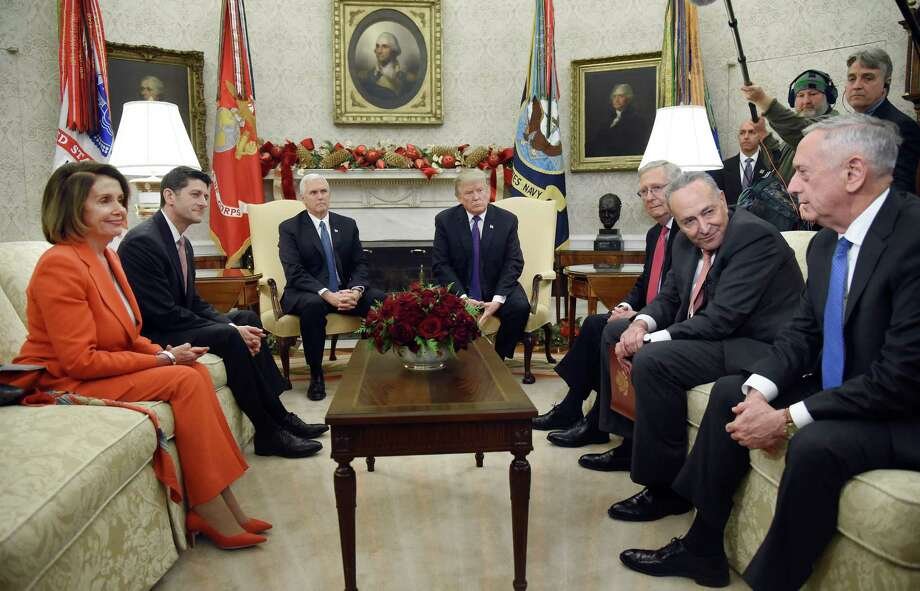 Jim Mattis, U.S. Secretary of Defense, from right, speaks as Senate Minority Leader Chuck Schumer, a Democrat from New York, Senate Majority Leader Mitch McConnell, a Republican from Kentucky, U.S. President Donald Trump, U.S. Vice President Mike Pence, U.S. House Speaker Paul Ryan, a Republican from Wisconsin, and House Minority Leader Nancy Pelosi, a Democrat from California, listen during a meeting in the Oval Office of the White House in Washington, D.C., U.S., on Thursday, Dec. 7, 2017. Trump is meeting with the congressional leaders from both parties to negotiate on a long-term budget deal as Congress prepares to pass a stopgap spending measure to avoid a U.S. government shutdown Saturday. Photographer: Olivier Douliery/Pool via Bloomberg ORG XMIT: 775089024 Photo: Olivier Douliery / © 2017 Bloomberg Finance LP