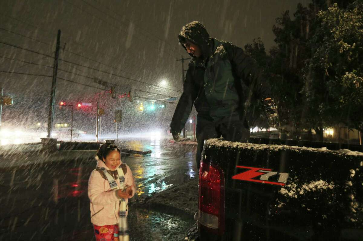 Siblings Ivan Moncada and Sofia Barrientos have fun as snow falls in San Antonio on Thursday, Dec. 7, 2017. Not since 2011, San Antonio residents experienced a bout of snow just after sunset which gave children and adults a chance to experience a winter wonderland in a city that mostly never sees the frosty precipitation. (Kin Man Hui/San Antonio Express-News)