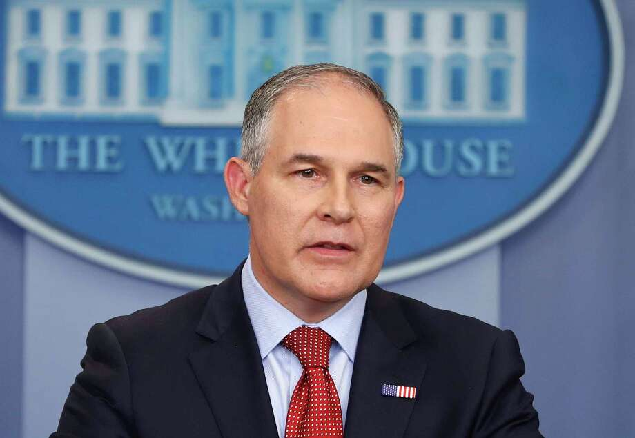 """Under the new administration, EPA chief Scott Pruitt appeared in every picture or video through the first months - often with one of his quotes, such as 'We as a nation can be both pro energy and jobs and pro environment. . . . We don't have to choose between the two.'"" Photo: Pablo Martinez Monsivais, STF / Copyright 2017 The Associated Press. All rights reserved."