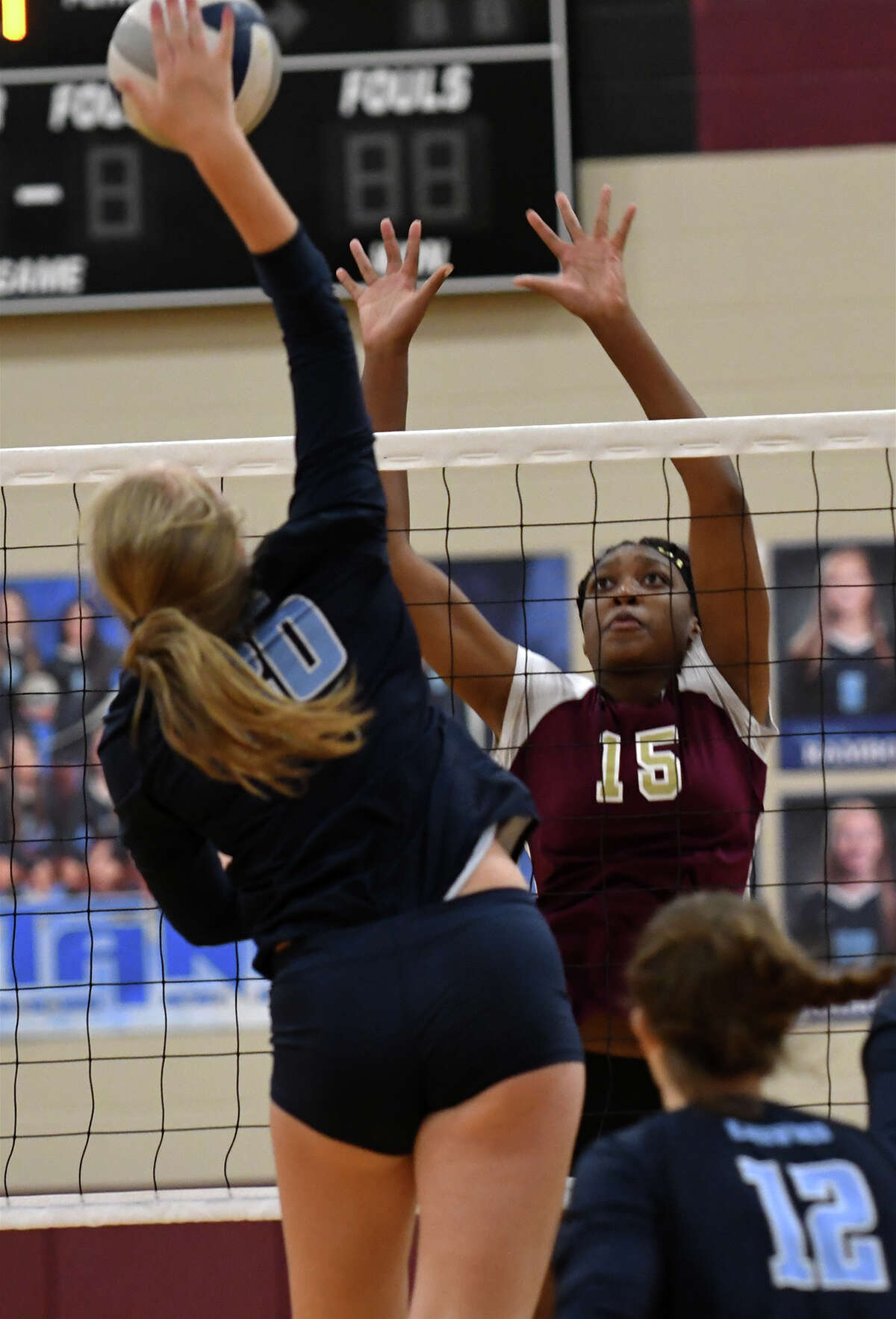 Summer Creek senior Burgandi Griffin (15) works for a block against Kingwood senior middle blocker Kayla Janikula (20) during their District 21-6A matchup at Summer Creek High School on Sept. 26, 2017. (Photo by Jerry Baker/Freelance)