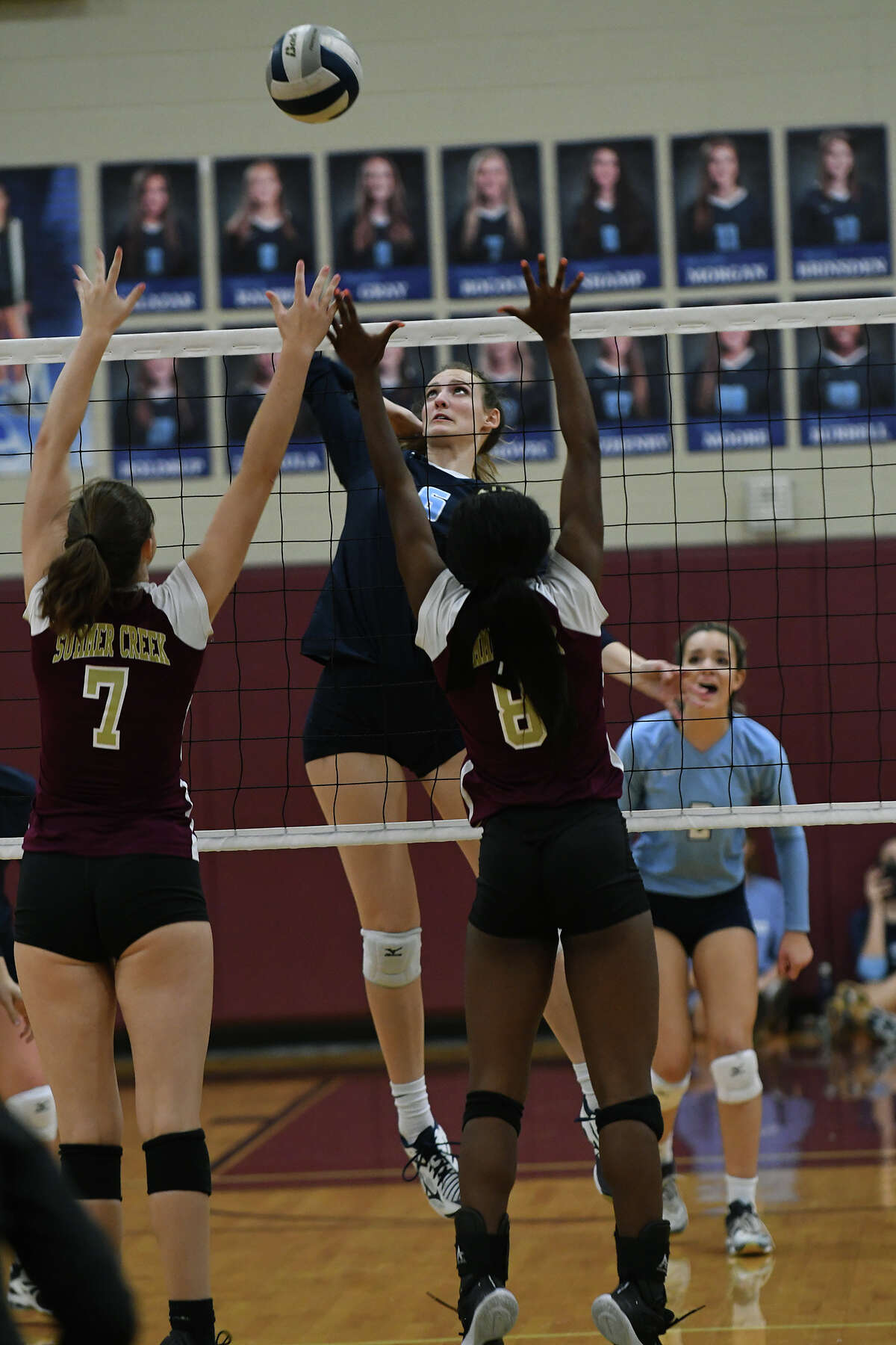 Kingwood junior middle blocker Camden Gray (6) attempts a kill against Summer Creek senior Regan Wright (7) and Lady Bulldog junior Amiya Matthews (8) during their District 21-6A matchup at Summer Creek High School on Sept. 26, 2017. (Photo by Jerry Baker/Freelance)