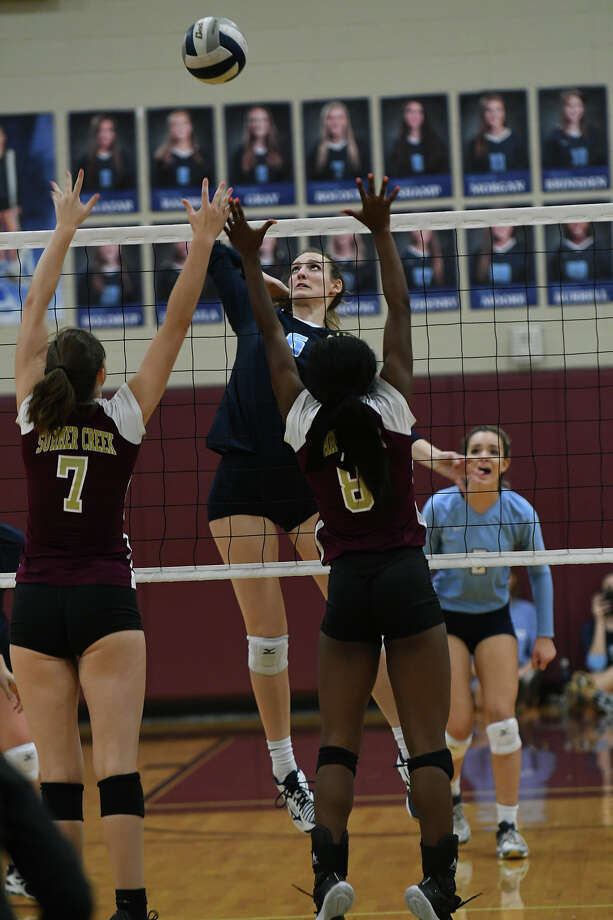 Kingwood junior middle blocker Camden Gray (6) attempts a kill against Summer Creek senior Regan Wright (7) and Lady Bulldog junior Amiya Matthews (8)  during their District 21-6A matchup at Summer Creek High School on Sept. 26, 2017. (Photo by Jerry Baker/Freelance) Photo: Jerry Baker, Freelance / Freelance