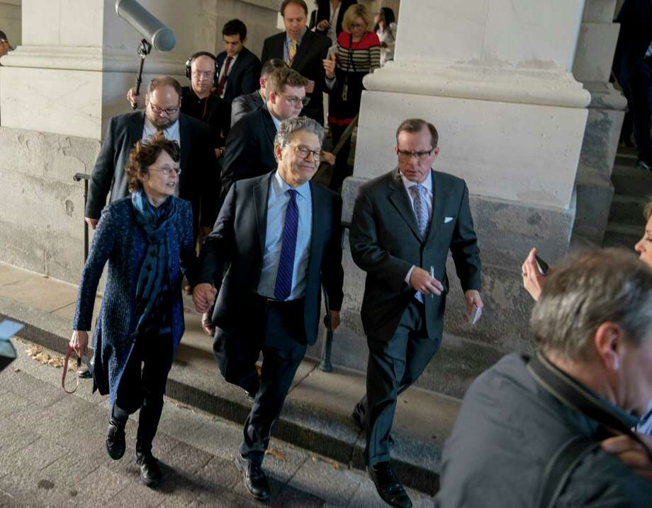 Sen. Al Franken, D-Minn., holds hands with his wife Franni Bryson, center left, as he leaves the Capitol after speaking on the Senate floor, Thursday, Dec. 7, 2017, on Capitol Hill in Washington. Franken said he will resign from the Senate in coming weeks following a wave of sexual misconduct allegations and a collapse of support from his Democratic colleagues, a swift political fall for a once-rising Democratic star. (AP Photo/Andrew Harnik) ORG XMIT: DCAH114 Photo: Andrew Harnik / Copyright 2017 The Associated Press. All rights reserved.