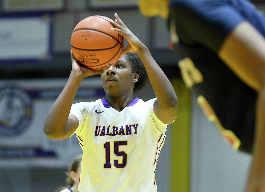 FILE — UAlbany's guard/forward Jessica Fequiere (15) shots a foul shoot against St. John's late in the second half of an NCAA college basketball game on Thursday, Nov. 30, 2017, in Albany, N.Y. St. John won the game71-66. Photo: Hans Pennink / 20042275A