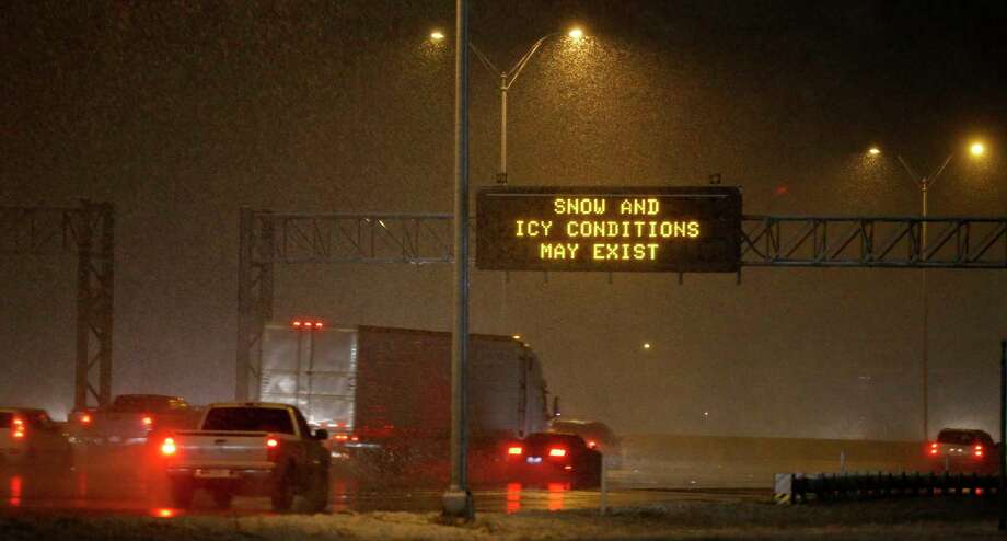 FILE — Motorist drive on IH-10 East as a snow storm moves through the San Antonio area Thursday, Dec. 7, 2017. Light snow may fall in South and Central Texas between late Monday night and Tuesday  evening, coupled with freezing rain and sleet, according to a National  Weather Service alert. Photo: Edward A. Ornelas, San Antonio Express-News / © 2017 San Antonio Express-News
