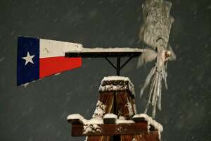 A windmill with snow Thursday Dec. 7, 2017 in Leon Springs.