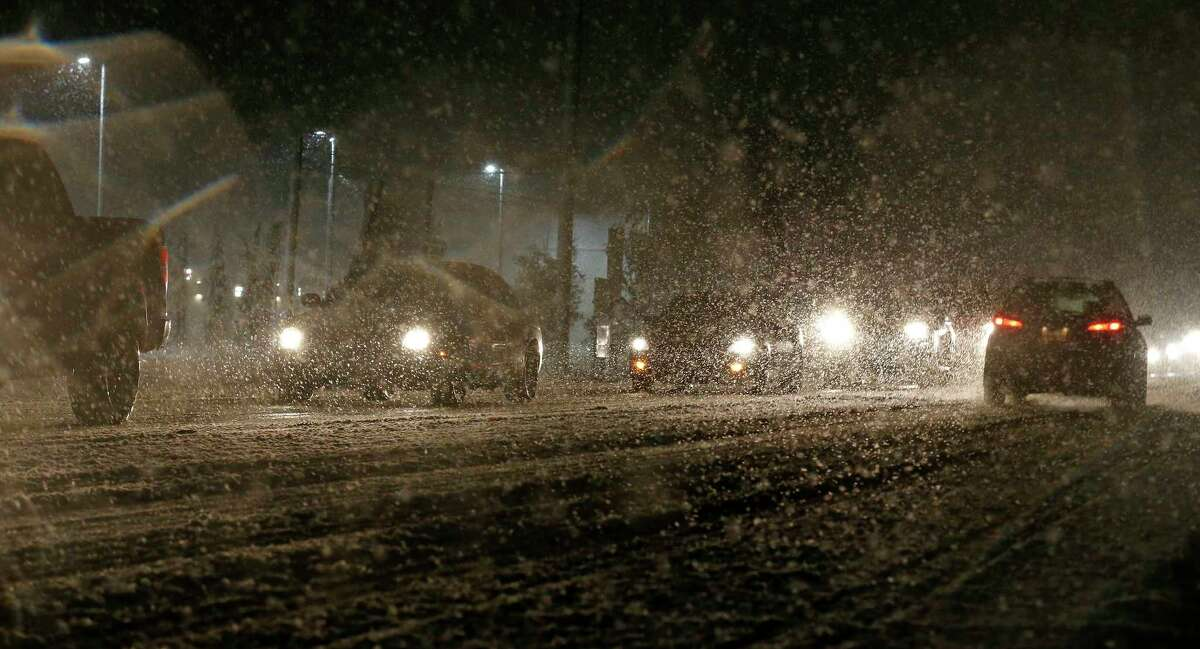 Motorist drive through snow and ice Thursday Dec. 7, 2017 in Leon Springs.