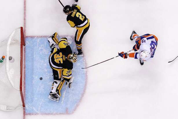 New York Islanders' Brock Nelson (29) scores agianst Pittsburgh Penguins goalie Tristan Jarry (35) during the third period of an NHL hockey game in Pittsburgh, Thursday, Dec. 7, 2017. The Penguins won in overtime, 4-3. (AP Photo/Gene J. Puskar) ORG XMIT: PAGP112