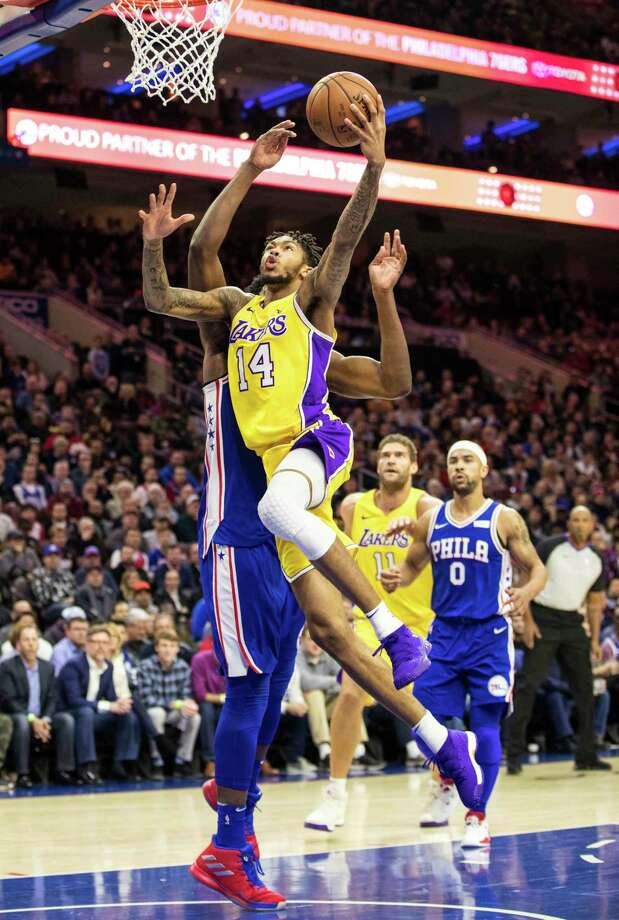 Los Angeles Lakers Brandon Ingram (14) goes up to shoot against Philadelphia 76ers Joel Embiid, of Cameroon, during the first half of an NBA basketball game, Thursday, Dec. 7, 2017, in Philadelphia. (AP Photo/Chris Szagola) ORG XMIT: PACS101 Photo: Chris Szagola / FR170982 AP
