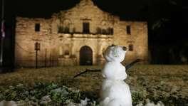A snowman and the Alamo Dec. 7.