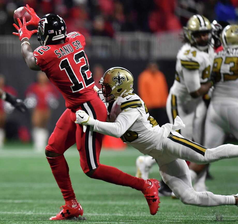New Orleans Saints cornerback P.J. Williams (26) hits Atlanta Falcons wide receiver Mohamed Sanu (12) as Sanu prepares to receive the ball during the second half of an NFL football game, Thursday, Dec. 7, 2017, in Atlanta. (AP Photo/Danny Karnik) ORG XMIT: GAMS143 Photo: Danny Karnik / FR56432 AP