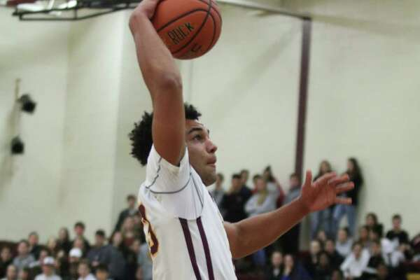 Colonie's Isaiah Moll goes up for a one-handed dunk and two points during the Suburban Council boys varsity basketball matchup against Ballston at Colonie High School Thursday, Dec. 7, 2017. (Ed Burke - Special to The Times Union)