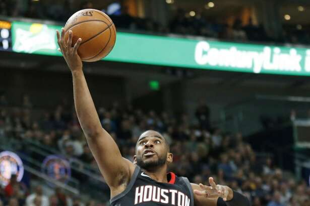 Houston Rockets guard Chris Paul (3) lays the ball up during the first half during an NBA basketball game against the Utah Jazz on Thursday, Dec. 7, 2017, in Salt Lake City. (AP Photo/Rick Bowmer)