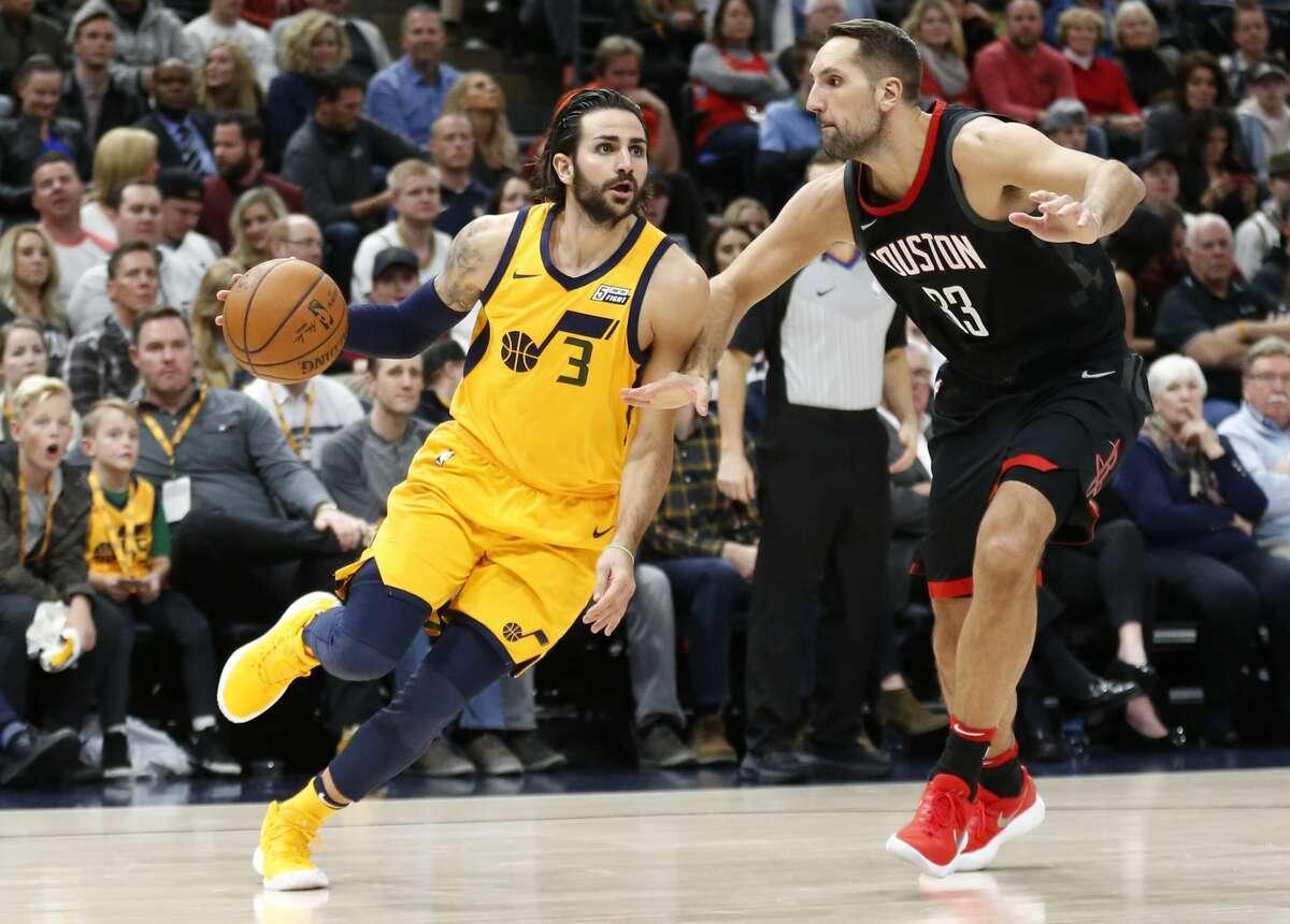 Utah Jazz guard Ricky Rubio (3) drives around Houston Rockets forward Ryan Anderson (33) in the second half during an NBA basketball game Thursday, Dec. 7, 2017, in Salt Lake City. (AP Photo/Rick Bowmer)