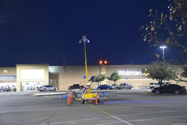 An off-duty Floresville police officer and a Walmart employee were attacked by a woman with a knife Friday morning on the Northwest Side.