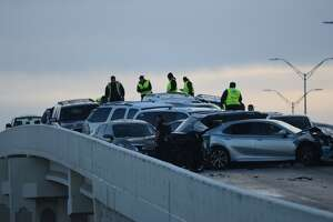 Slick conditions after a night of snow and freezing temperatures likely contributed to a multi-car pileup along a ramp at Loop 410 and Jackson Keller on Friday morning, Dec. 8, 2017.