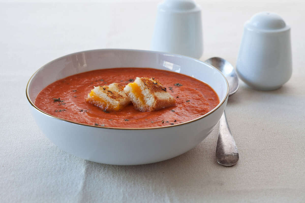 Tomato Soup with Grilled Cheese Croutons is a perfect cold weather meal.