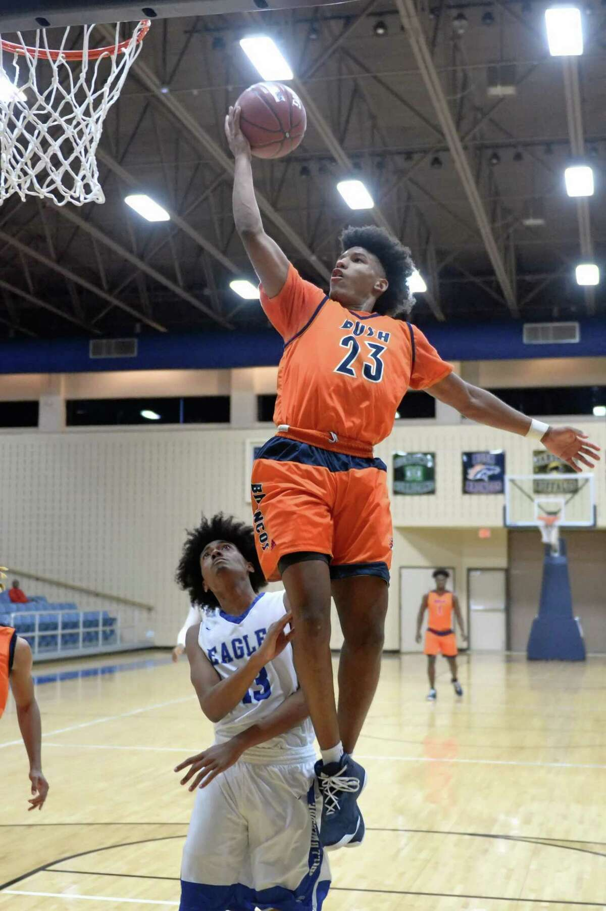 Peter Byrd (23) of Bush drives to the hoop during pool play in the Fort Bend ISD Balfour Basketball Tournament between the Bush Broncos and the Willowridge Eagles on Thursday December 7, 2017 at Wheeler Field House, Sugar Land, TX