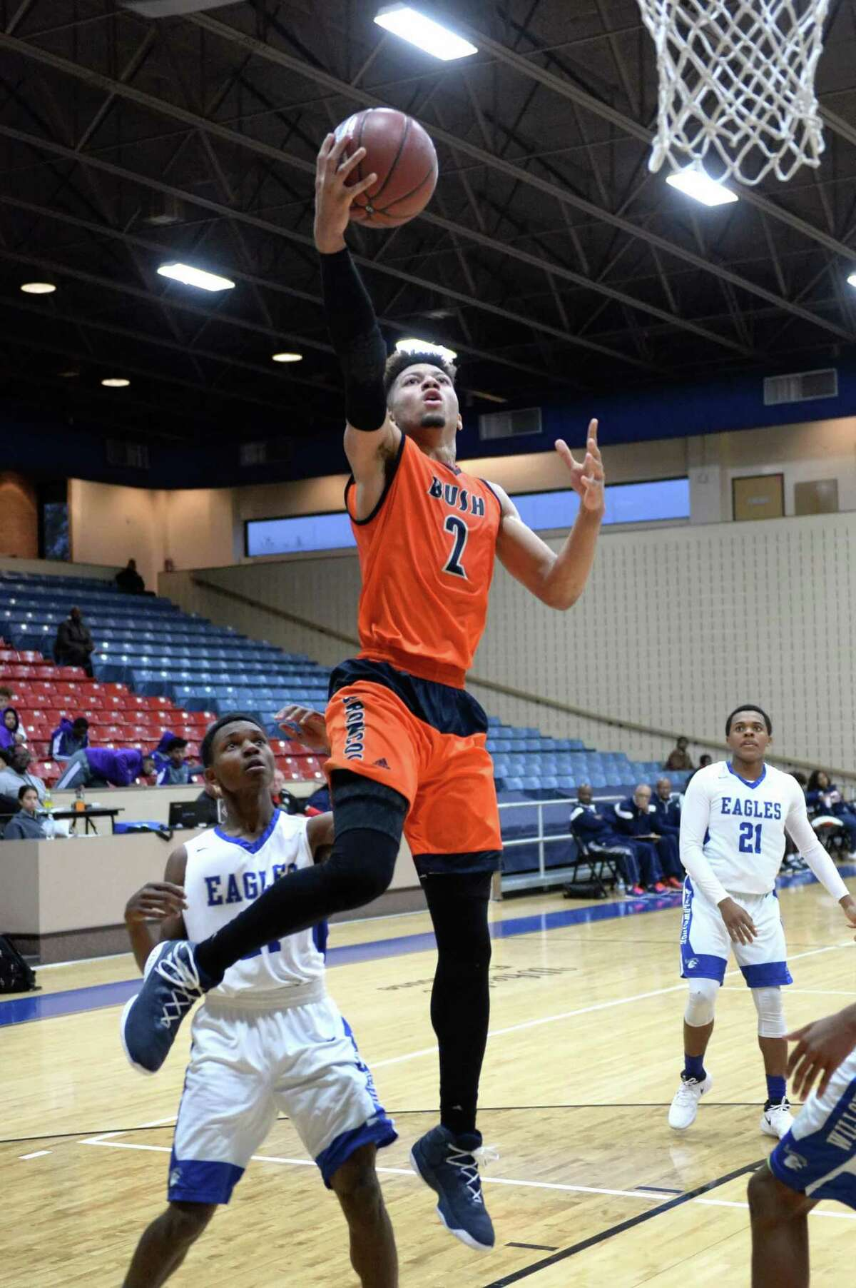 Kyle Slater (2) of Bush drives to the hoop during pool play in the Fort Bend ISD Balfour Basketball Tournament between the Bush Broncos and the Willowridge Eagles on Thursday December 7, 2017 at Wheeler Field House, Sugar Land, TX