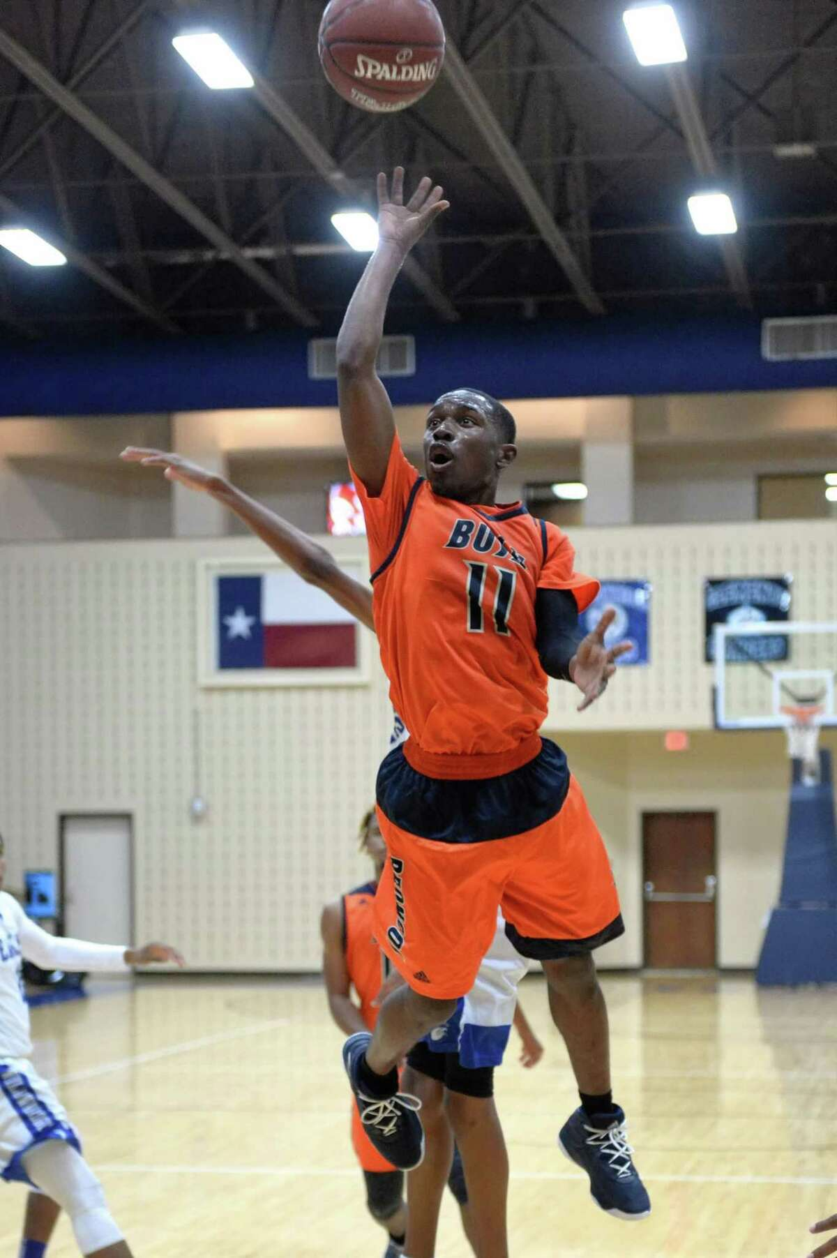 Remy Minor (11) of Bush makes a jump shot during pool play in the Fort Bend ISD Balfour Basketball Tournament between the Bush Broncos and the Willowridge Eagles on Thursday December 7, 2017 at Wheeler Field House, Sugar Land, TX