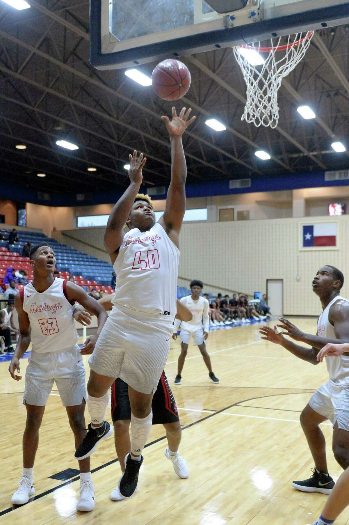 Dequarius Gibson (40) of Westfield drives to the hoop during pool play in the Fort Bend ISD Balfour Basketball Tournament between the Westfield Mustangs and the Oak Ridge War Eagles on Thursday December 7, 2017 at Wheeler Field House, Sugar Land, TX