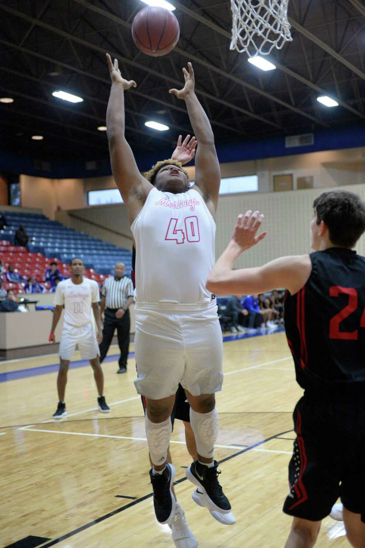 Dequarius Gibson (40) of Westfield grabs a rebound during pool play in the Fort Bend ISD Balfour Basketball Tournament between the Westfield Mustangs and the Oak Ridge War Eagles on Thursday December 7, 2017 at Wheeler Field House, Sugar Land, TX