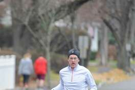 First-place finisher Ed Banks, of Darien, runs down the final stretch in the 30th Annual William Raveis Jingle Bell Jog in Greenwich, Conn. Sunday, Dec. 3, 2017. Presented by Threads & Treads, the race took costume-clad runners along a 3-mile course beginning a the YMCA and traveling north by the Brunswick School and Greenwich Academy campuses.