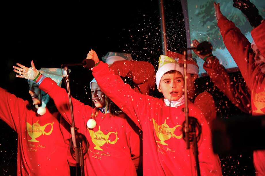 The cast of Aladdin Jr. from Saxe Middle School, in New Canaan, Conn., sing a carol during the annual Heights & Lights event in downtown Stamford, Conn. on Sunday, Dec. 3, 2017. Photo: Michael Cummo / Hearst Connecticut Media / Stamford Advocate